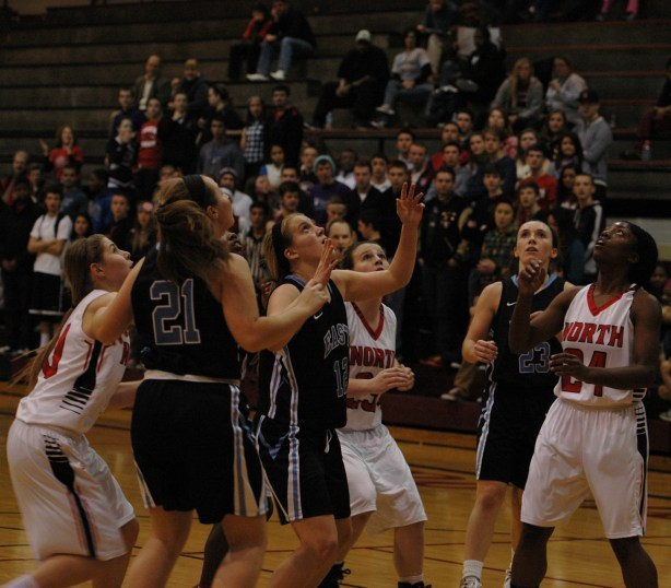 Senior Emily Dodd goes up for the rebound. Photo by Katie Lamar