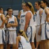 The team huddles during a time out and listens to their coach talk. Photo by Kylie Rellihan.