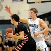 Senior Luke Haverty guards SM North guard. Photo by Callie McPhail