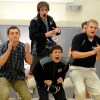 Sophomores Mike Bamford, Michael Aldrich, senior Chris Rodriguez, and a coach cheer on a variety match. Photo by Katie Lamar