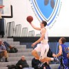 Sophomore Joey Wentz goes in for a lay up. Photo by Marisa Walton