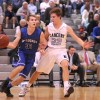 Junior Gunnar Englund guards Harrisonville senior John Koch. Photo by Marisa Walton