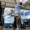 Junior Gunnar England goes up for 2 points.  Photo by Maddie Schoemann
