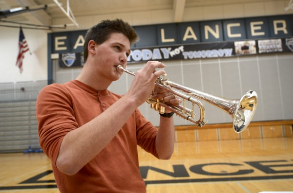 Sophomore Bennet Lawrence practices trumpet and periodically increases the speed of the metronome, increasing the difficulty of the piece he is playing.  Photo by Maxx Lamb