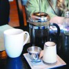 French Press Coffee machine complete with cream and sugar.