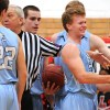 The referee calls a jump ball after a tussle between senior Luke Haverty (far right) and sophomore Price Morgan (not pictured). Photo by Marisa Walton