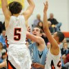 Sophomore Joey Wentz tries to shoot around senior Jake Horner, #5, and senior Brady Skeens, #22. Photo by Marisa Walton