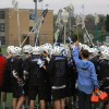 The team joins together at half time before returning to the game. By Katie Lamar