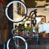 A bike mounted on the wall along with a portrait of a bike race help to add to the down-to-earth atmosphere of the coffee shop.