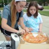 Maria Dunn and Jill Witwer take a break and enjoy a fresh slice of pizza. Photo by Annika Sink