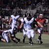 Senior Kyle Ball chases down the North quarterback in the backfield. Photo by Allison Stockwell.