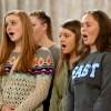 Senior Rilye Fries tips her head as the choir sings their first song. Photo by Kaitlyn Stratman.