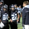 Coach Delaney discusses the next play with the defense. Photo by Joseph Cline.