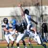 Junior Luke Hiesdorfer jumps in attempt to get the ball. Photo by Hailey Hughes