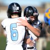 Gunnar Englund embraces senior Charley White after his second touchdown of the game. Photo by Hailey Hughes