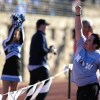 """Senior Dan Walker reacts to the crowd after they chanted """"Dan the Man"""". Walker has been the teams manager for the past two years. Photo by Hailey Hughes"""