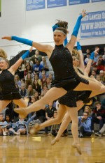 Senior Audrey Phillip leaps in the middle of the Lancer Dancers performance. Photo by Julia Poe.