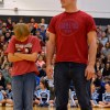 Senior Kyle Ball stands by his upcoming opponent in the Coalition Pie Eating contest. Photo by Julia Poe.