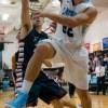 Senior Gunnar Englund fights for the ball under the basket. Photo by James Wooldridge