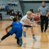 """Guarded by Rockhurst's senior Cartier Dean, senior Jack Flint makes a cut. """"It's early in the season and we've got a lot to learn as a team but I can see we are already showing some of our potential and should have a fun season."""" Photo by James Wooldridge"""