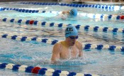 Senior Ben Schmatz gasps for air during the breast stroke in the 200 IM. Photo by Annie Lomshek.