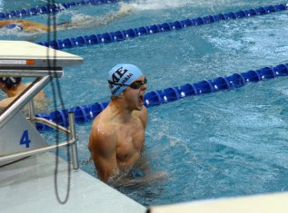 Swimming the 100 yard Freestyle, Sophomore Joe McGuire receives a 51.20 time for a state cut. Photo by Annie Lomshek.