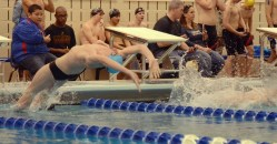 Sophomore Ian Longan arches back to begin the 100 yard Backstroke. He places 5th with a time of 58.05, only 0.05 seconds behind his teammate Evan Root. Photo by Annie Lomshek.