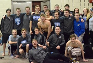The team poses for a group shot after a successful meet. Photo by Annie Lomshek.