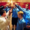 The players huddle in the locker room before the game. Photo by James Wooldridge