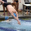 Sophomore Ian Longan dives in after Joe McGuire finishes his lap. Photo By Annie Lomshek