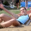 Senior Rachel Haskell slides on the sand after her long jump. Photo by Morgan Browning