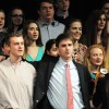 Newly-inducted NHS members sing the school song to conclude the ceremony. Photo by Haley Bell
