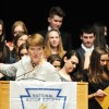 NHS Sponsor Jeannette Bonjour acknowledges the new members during applause. Photo by Haley Bell