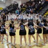The East cheerleaders and students form a circle on the court to sing the school song after the game. Photo by James Wooldridge