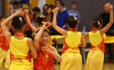 Chinese cultural dancers perform a festive dance. Photo by Annie Lomshek.