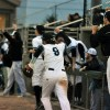 Senior Max Sanborn cheers along with his teammates for a player at bat. Photo by Allison Stockwell