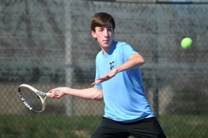 Junior Jacob Ye prepares to hit a forehand. Photo by Hailey Hughes
