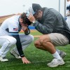 Senior Max Sanborn and junior Charlie Jensen crouch together on the turf after the loss. Photo by James Wooldridge