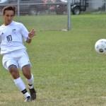 Senior Derrick McClanahan kicks the ball to a teammate. Photo by Abby blake