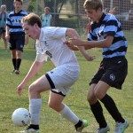Senior Michael Mardikes takes the ball from Junior Grant Minick. Photo by Abby Blake