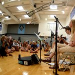 Seniors Oscar Motsinger and Chloe Kerwin perform in front of the pancake eaters. Photo by Kaitlyn Stratman
