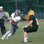 Senior Jack Tyler attempts to juke past a defender.  Photo by Tess Iler