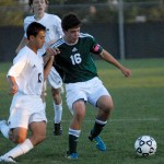 Senior Lucas Adel attempts to gain possession of the ball.  Photo by Tess Iler