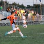 Sophomore Collyn Lowry punts the ball away from the goal.  Photo by Tess Iler
