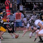 The defense prepares for South to snap the ball.  Photo by Tess Iler