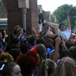 Senior Andrew Stottle crowd surfs before the pep rally in The Village. Photo by Hannah McPhail