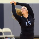 Freshman Andie McConnell saves a shanked ball by passing it over the net. Photo by Morgan Browning