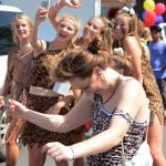 Junior Annie Lomshek dances while her Girls' Soccer teammates take a picture behind her. Photo by Morgan Browning