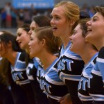 The senior cheerleaders come together at the end of assembly to sing the school song. Photo by Abby Blake