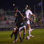 Senior Luke Ehly jumps and collides with two South players. Photo by Diana Percy